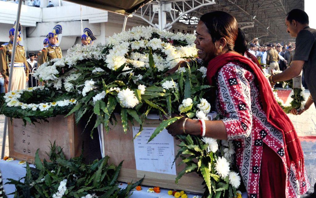 A bereaved family member of martyr Sudip Biswaws, one of the 49 CRPF men killed in 14 Feb Pulwama militant attack, at Netaji Subhas Chandra Bose International Airport in Kolkata on Feb 16, ...