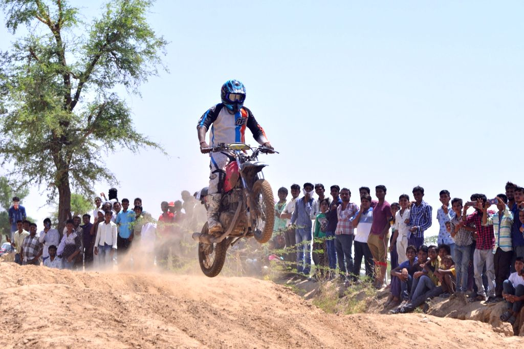 A biker participates in Supercross bike race in Jodhpur on June 5, 2016.