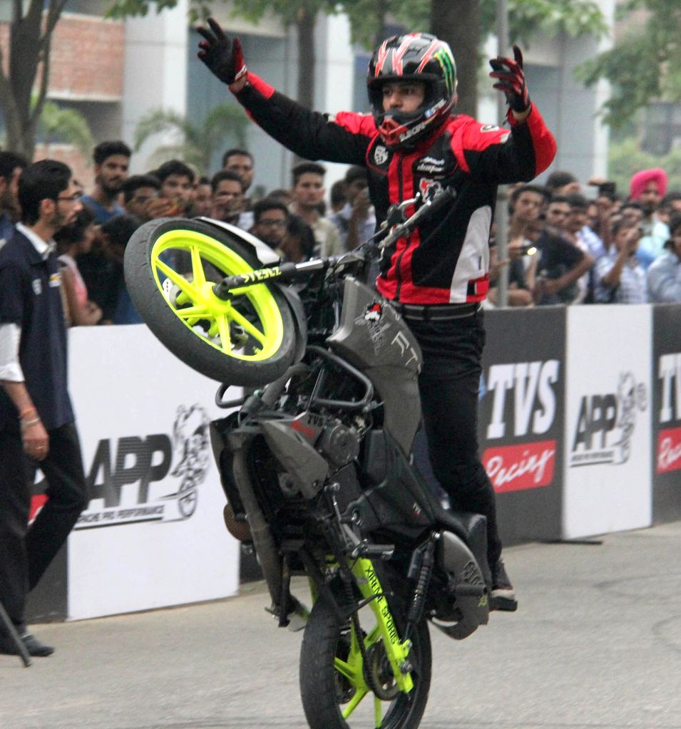 A biker performs stunt during a programme in Jalandhar on Oct 20, 2015.