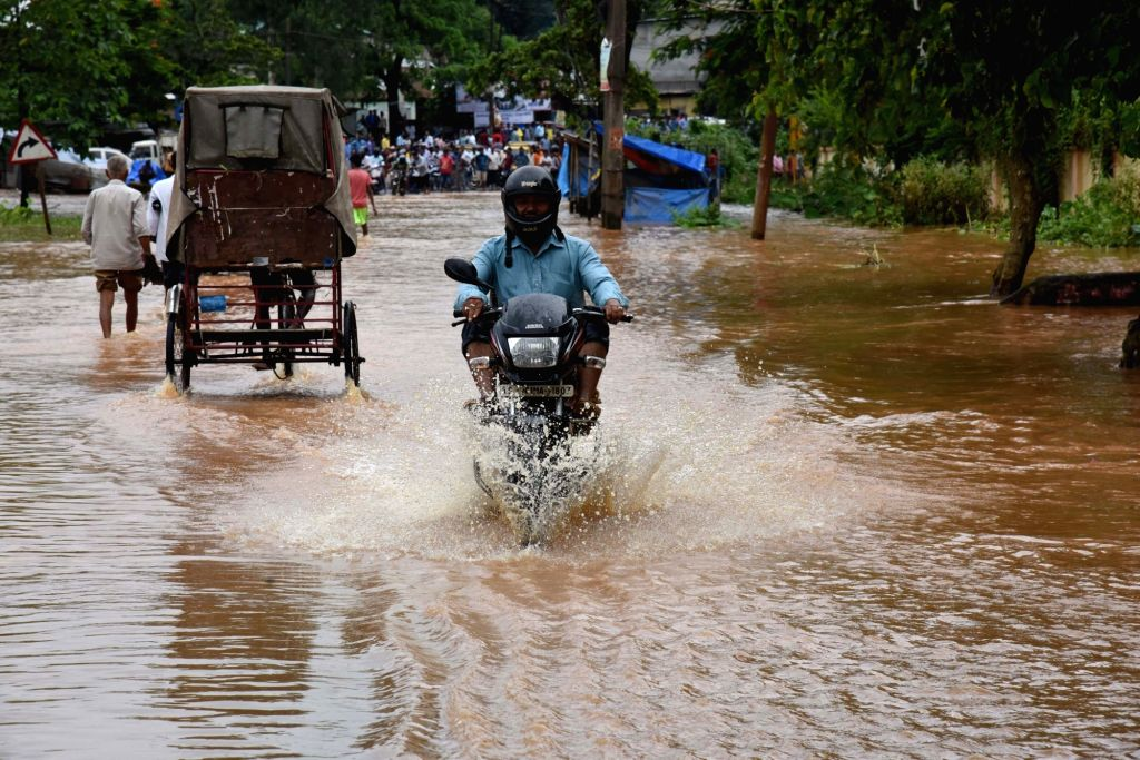 A biker struggles through waterlogged streets of Guwahati after heavy rains lashed the city on July 3, 2107.