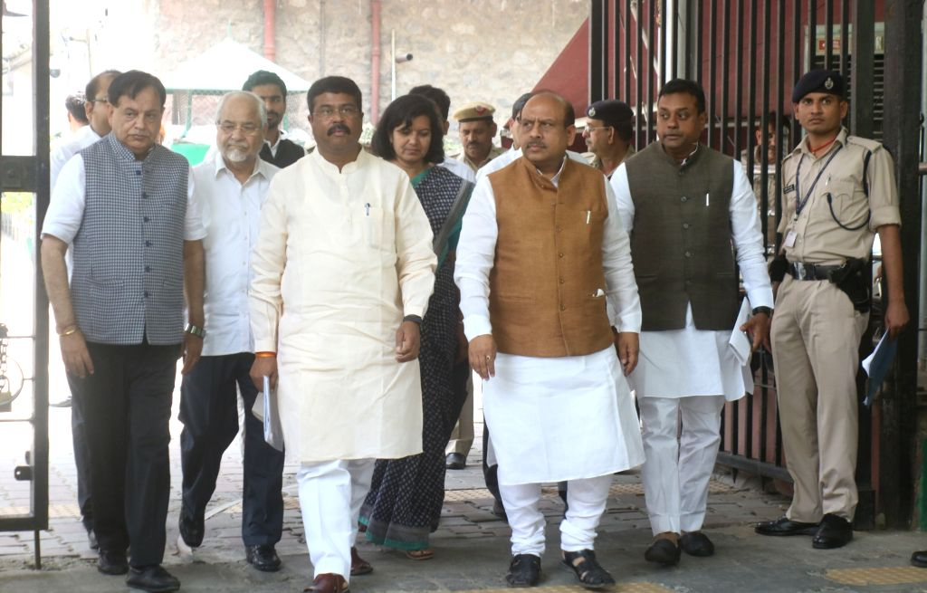 A BJP delegation led by Union Minister Dharmendra Pradhan and party leaders Sambit Patra and Vijender Gupta, come out after meeting the Chief Election Commissioner (CEC) in New Delhi, on ... - Dharmendra Pradhan and Vijender Gupta