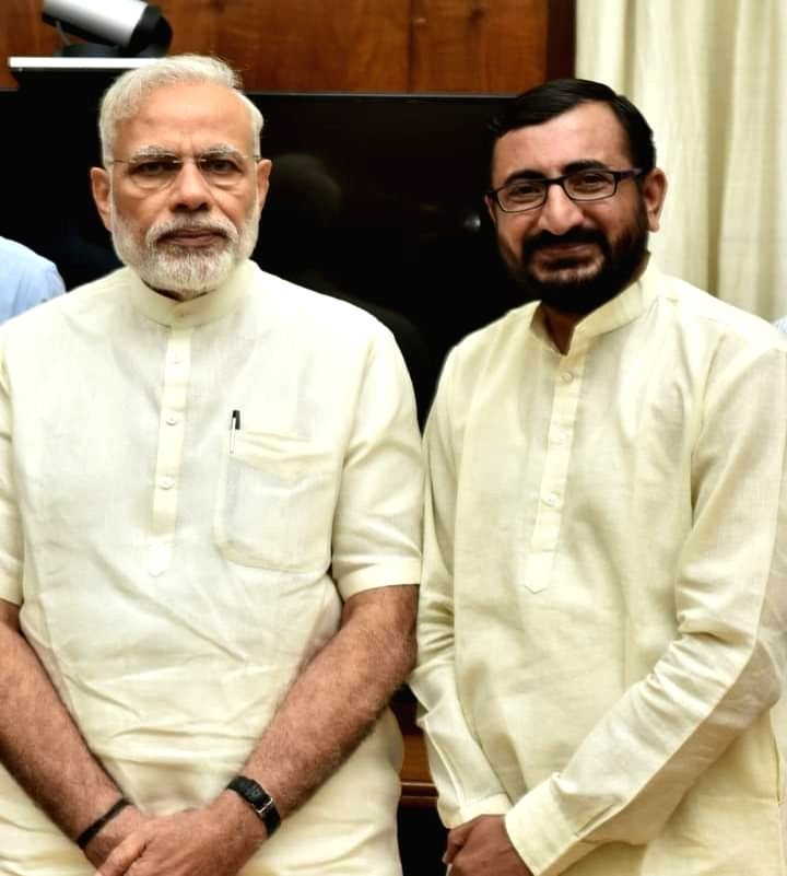 A BJP leader Manish Bhanushali (with PM), now accused by the NCP National Spokesperson and Minister Nawab Malik of taking part in the NCB raids on a cruise ship on Oct. 2(photo:instagram) - Nawab Malik