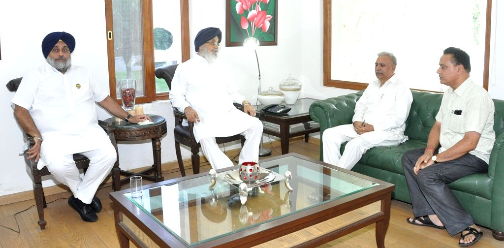 A BJP-RSS delegation calls on Punjab Chief Minister Parkash Singh Badal over attack on senior RSS functionary Brigadier (Retd) Jagdish Gagneja in Chandigarh on Aug 8, 2016. Also seen ... - Parkash Singh Badal and Sukhbir Singh Badal
