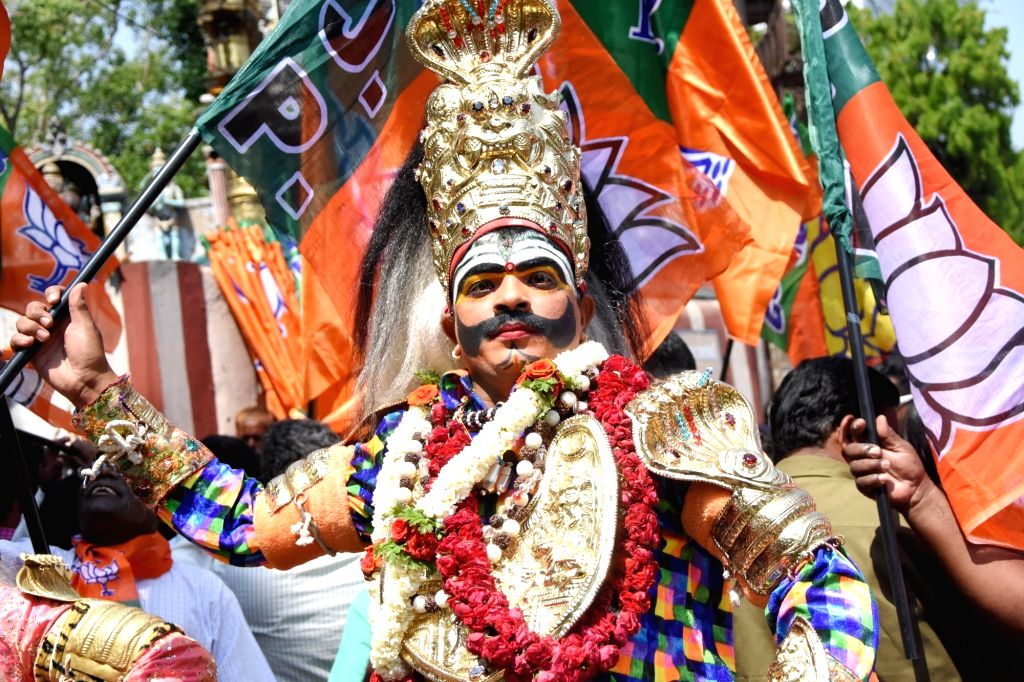 A BJP supporter accompanies the party's Lok Sabha candidate from Bengaluru North, D.V. Sadananda Gowda as he heads to file his nomination for 2019 Lok Sabha elections in Bengaluru, on ...