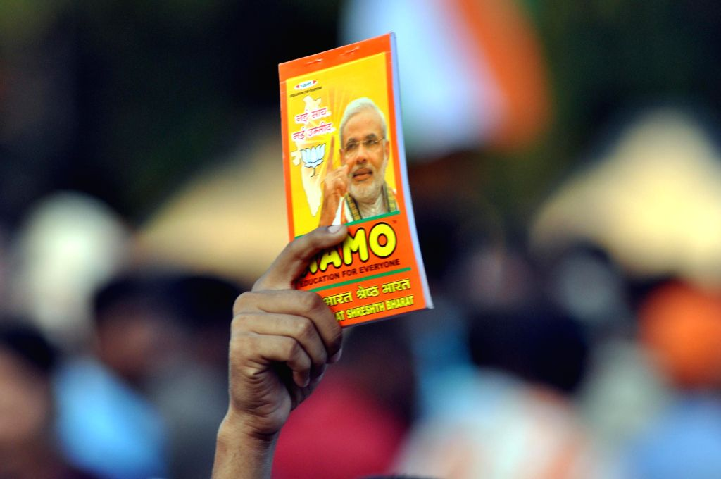 A BJP supporter at BJP Prime Ministerial candidate and Gujarat Chief Minister Narendra Modi's rally in Kolkata on May 7, 2014.