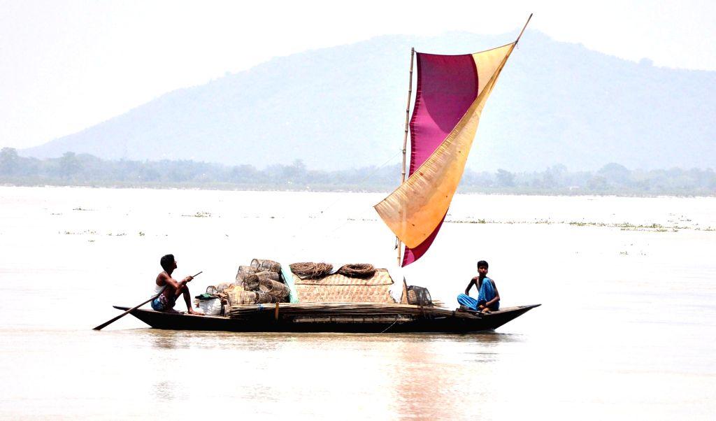 A boat on  Brahmaputra river near Guwahati on May 15, 2014.