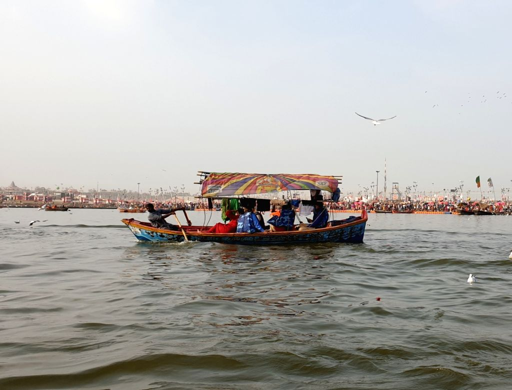 A boatman rows a boat on the Ganga river in Prayagraj.