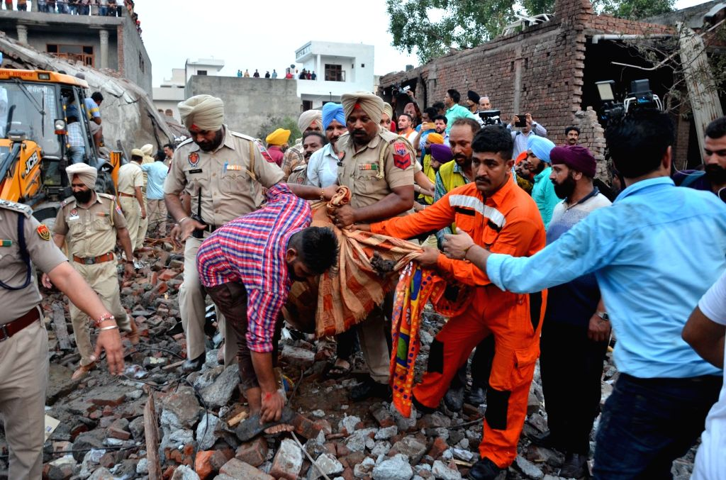A body being retrieved from the site of a blast at an unauthorized firecracker factory in a residential in Batala town of Punjab's Gurdaspur district on Sep 4, 2019. At least 19 people ...