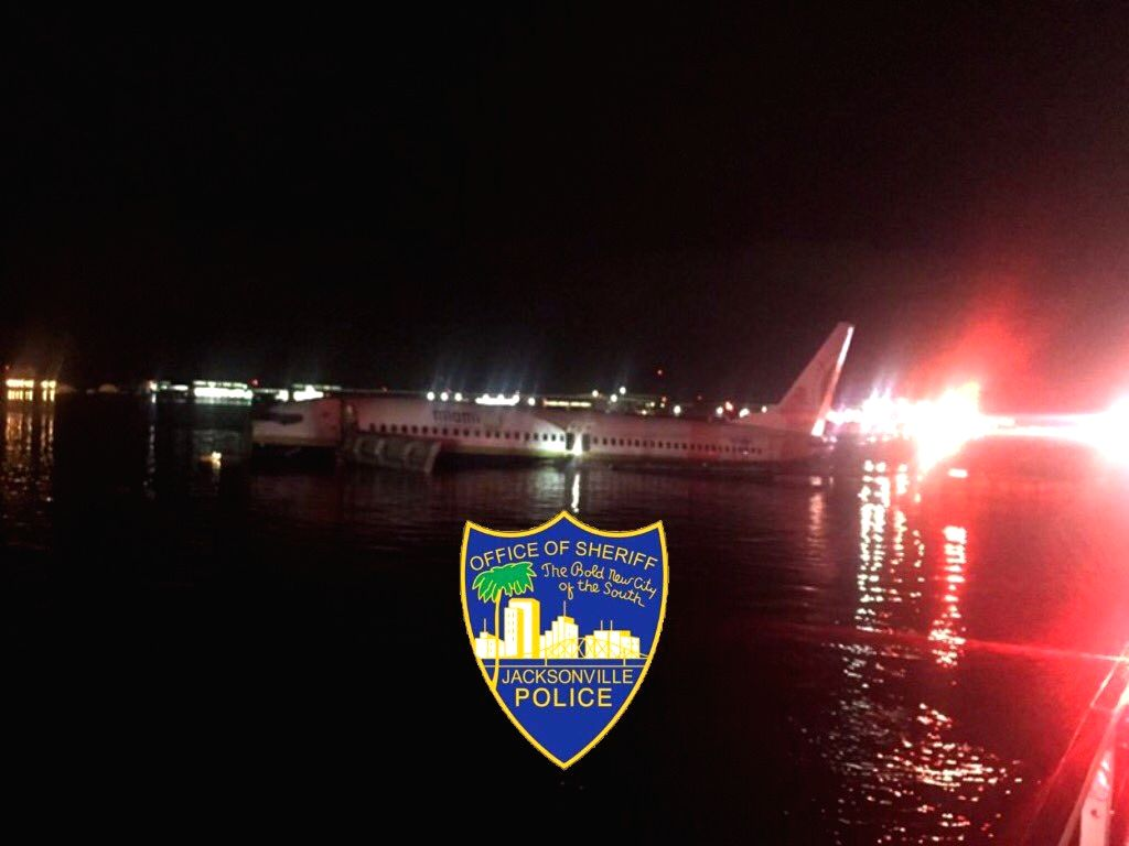 A Boeing 737 charter jet seen floating on the St. Johns River in Florida after crashing on May 4, 2019. Twenty-one people were injured in the Friday night incident when the pilot attempted ...