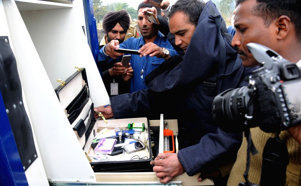 A bomb disposal squad personnel examine the content of an unattended briefcase after bomb threat claims at Sri Guru Ram Dass Jee International Airport in Amritsar on March 15, 2017.