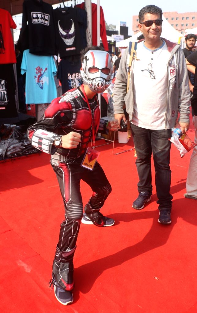 """A boy dressed up as comics superhero """"Ant-Man"""" at the three-day fest - """"Comic Con"""" in New Delhi on Dec 8, 2018."""