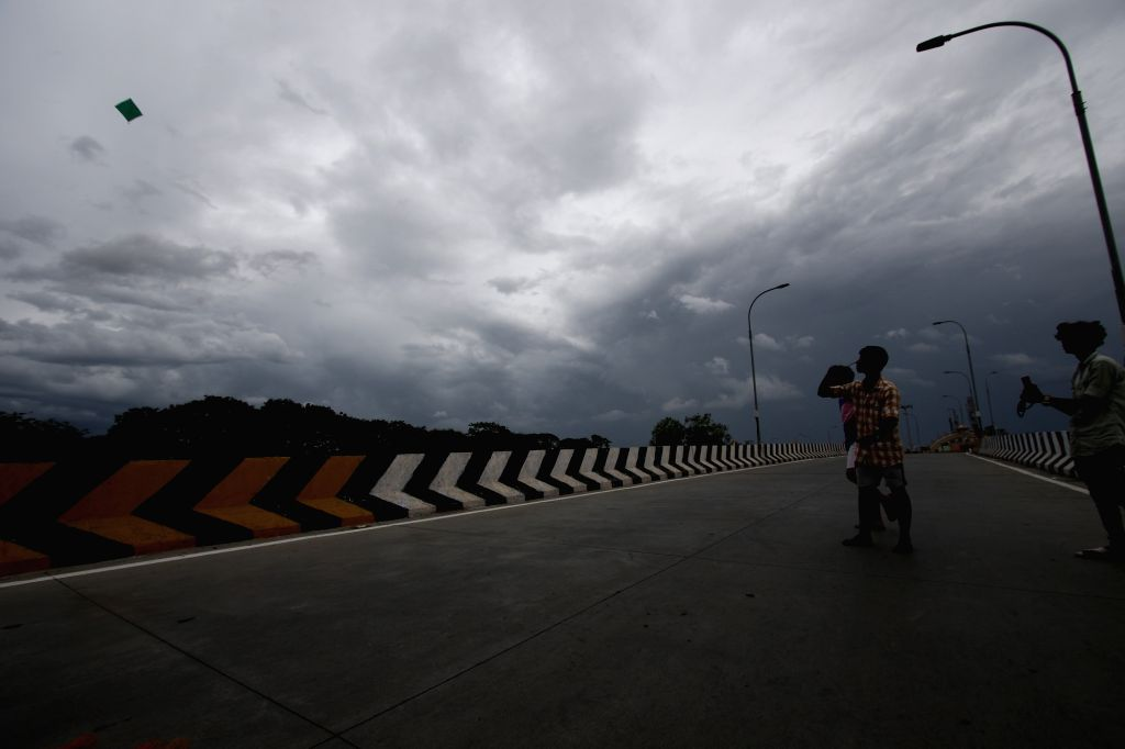 A boy flies a kite in an empty bridge during the fifth phase of the nationwide lockdown imposed in the wake of the corona pandemic, in Chennai on July 3, 2020.