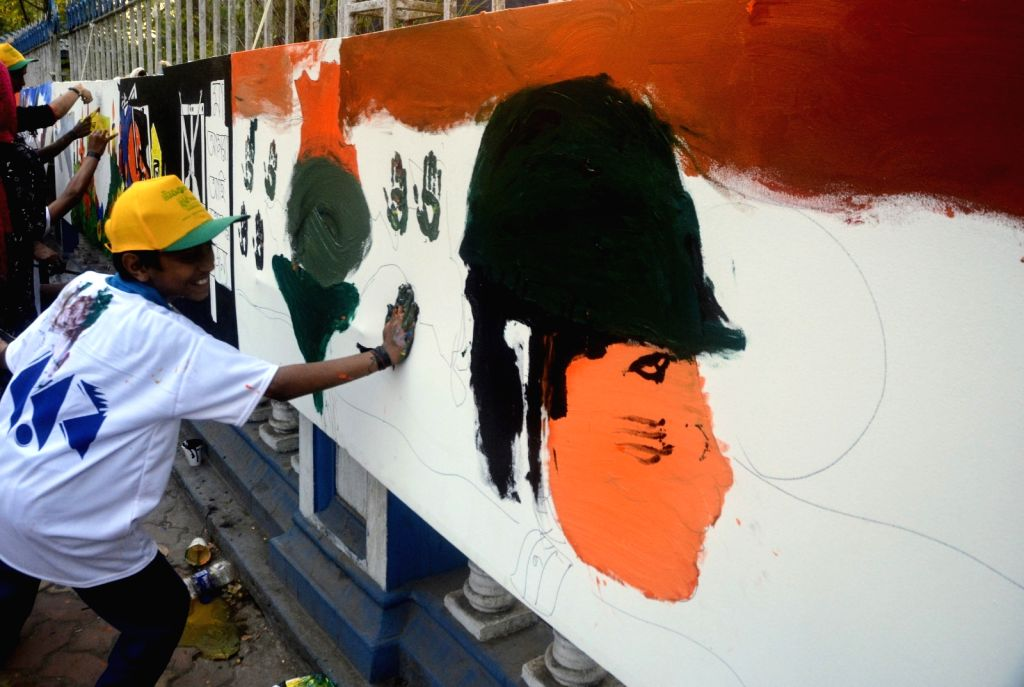 A boy participates in a painting programme to pay tributes to 49 CRPF men killed in Jammu and Kashmir's Pulwama district militant attack on 14th Feb 2019; in Kolkata, on Feb 17, 2019.