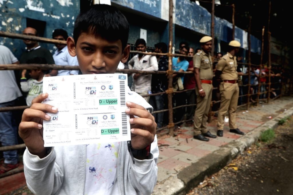 A boy shows tickets of 1st ODI match between India and West Indies on 15th December, at M. A. Chidambaram Stadium in Chennai on Dec 8, 2019.