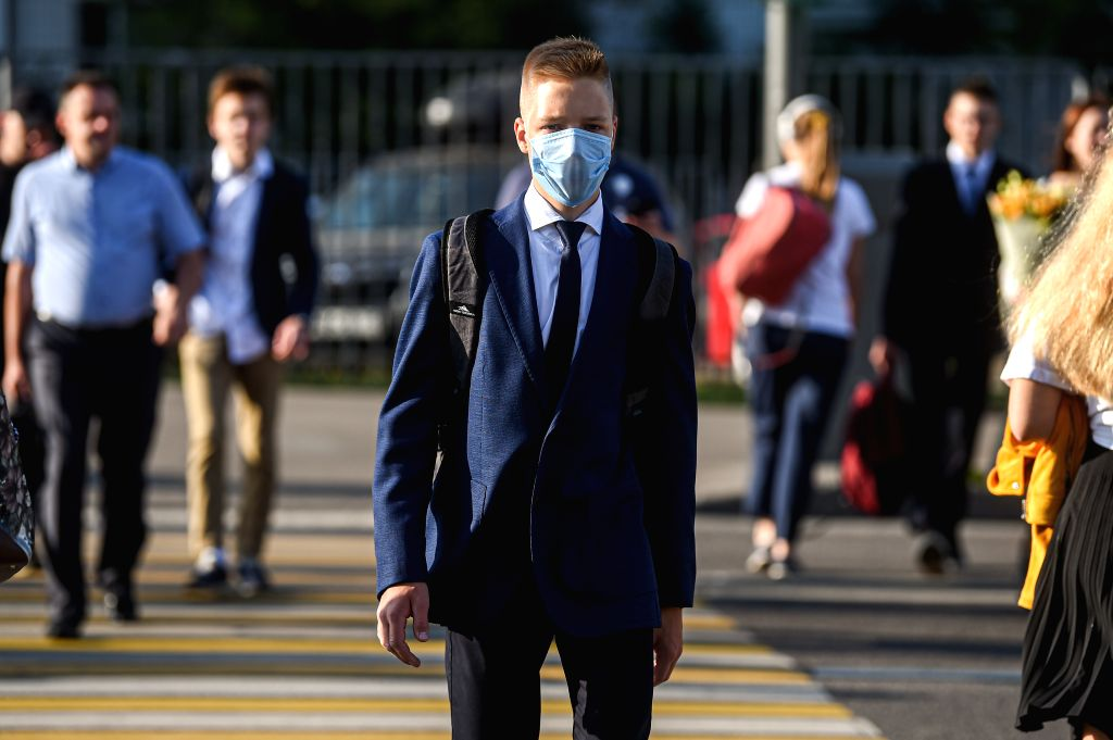 A boy walks near a school entrance on the first day of school in Moscow, Russia, on Sept. 1, 2020. Russia registered 4,729 new COVID-19 cases in the past 24 hours, ...