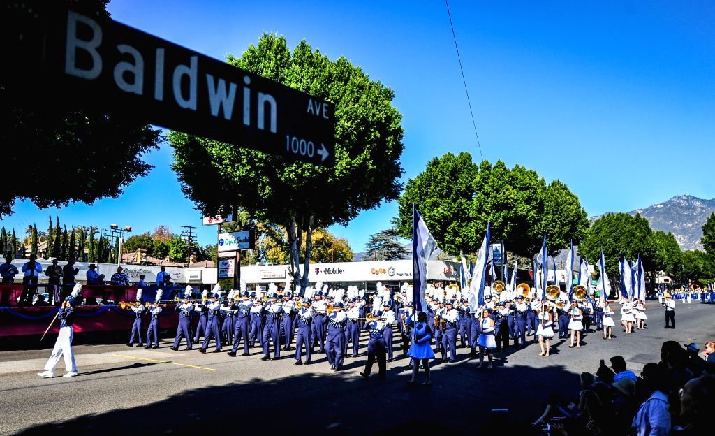A brass band from a high school of southern California attends the 62nd Festival of Bands Parade in the Baldwin Avenue in Arcadia, Los Angeles, the United ...