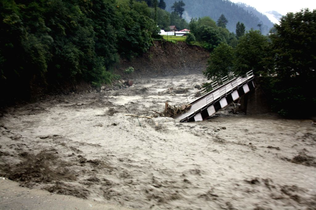A bridge connecting Barramulla and Uri road  damaged due to flood and landslides after heavy rain in Uri, Srinagar on Sept. 6, 2014.