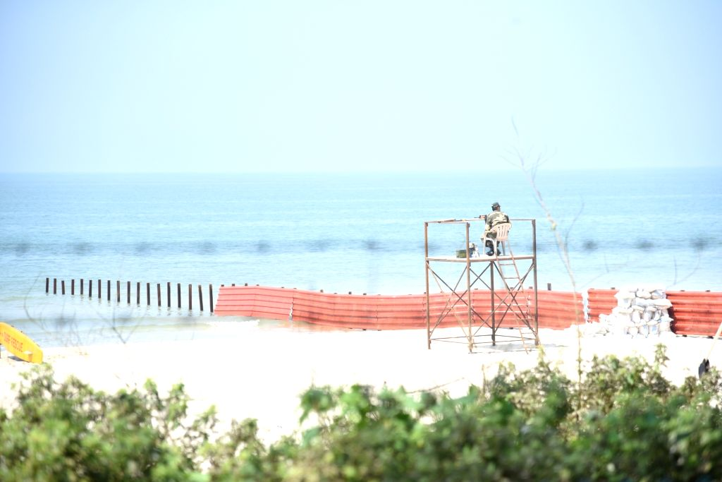 A BSF personnel guard a temporary tower during the BRICS summit at Cavelossim beach, Goa on Oct 15, 2016.