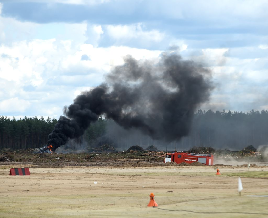 A burning Mi-28N helicopter is seen after crashing in Ryazan, Russia, Aug. 2, 2015. A Mi-28N helicopter crashed in central Russia's Ryazan Region, killing at least a ...