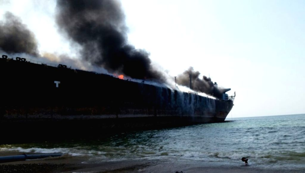 A burning ship is seen at the explosion site in southwest Pakistan's Hub, Nov. 1, 2016. At least 10 laborers were killed and over 50 others injured in an explosion ...