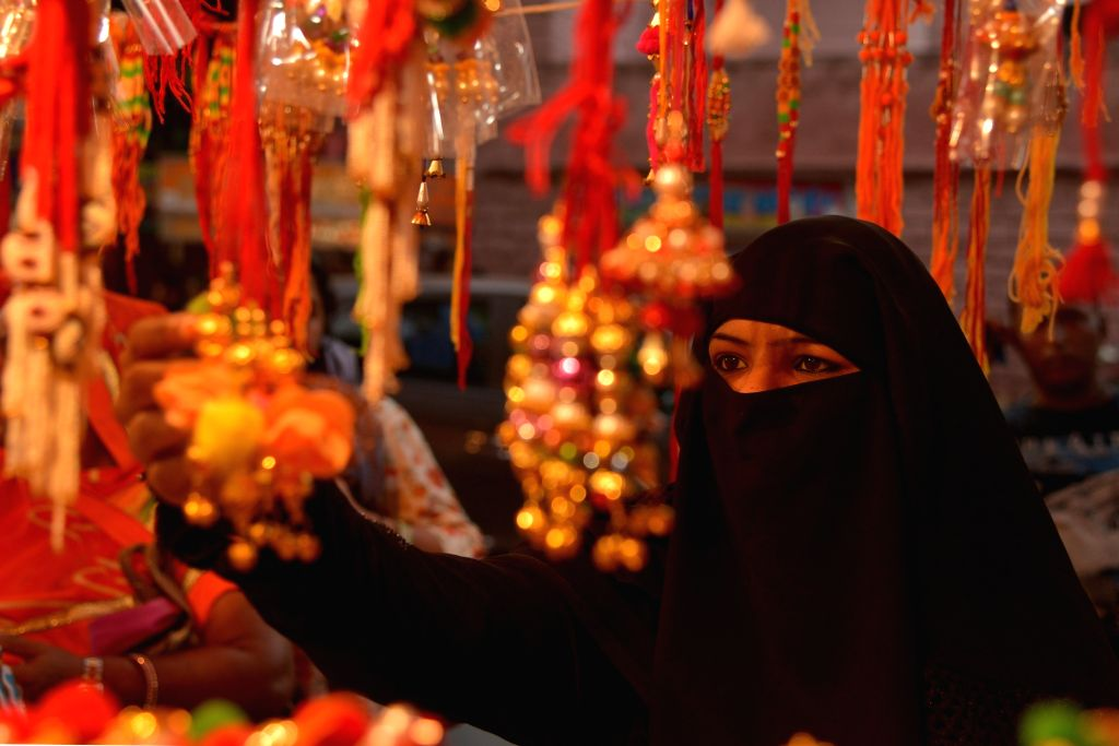 A burqa-clad woman busy shopping for Raksha Bandhan on the eve of the festival, at a market in Rajasthan's Ajmer on Aug 14, 2019.
