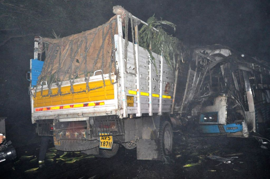 A bus and a truck collide head-on at Bowenpally, Hyderabad on Sept 9, 2014. The bus caught after the impact, in which three persons are reported to be charred to death and 25 others injured.