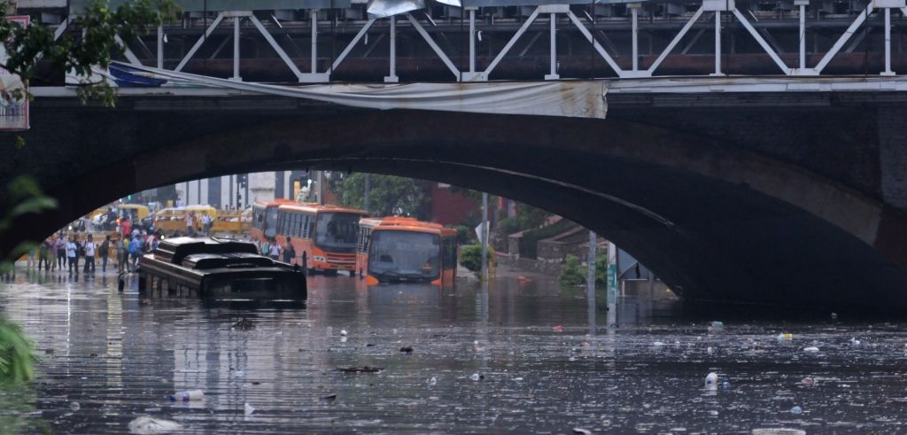 A bus gets partially submerged under Delhi's Minto bridge after heavy rains lashed the national capital on July 13, 2018.