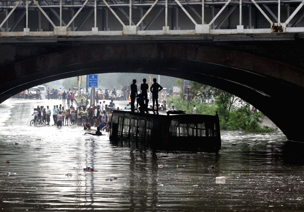 A bus gets partially submerged under Delhi's Minto bridge after heavy rains lashed the national capital on July 16, 2018.