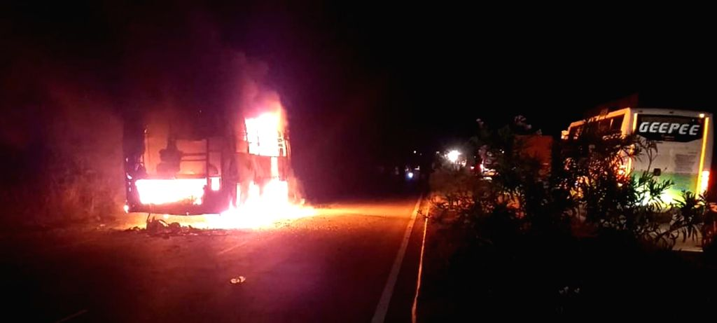 A bus heading from Hyderabad to Bangalore catches fire near Enugumarri village of Kurnool district in Andhra Pradesh, on June 6, 2019. All the passengers escaped unhurt.