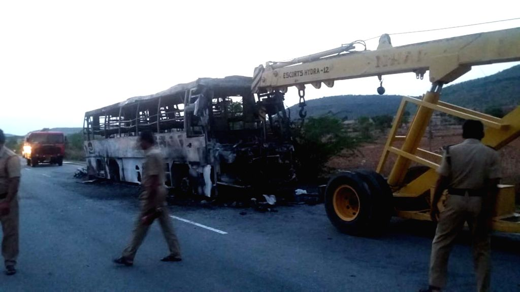 A bus heading from Hyderabad to Bangalore that had caught fire being removed, near Enugumarri village of Kurnool district in Andhra Pradesh, on June 6, 2019. All the passengers escaped ...