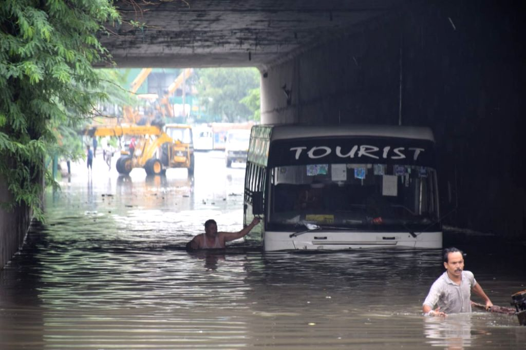 A bus seen partially submerged under water at an underpass in New Delhi after the national capital received heavy monsoon showers, on Aug 13, 2020.