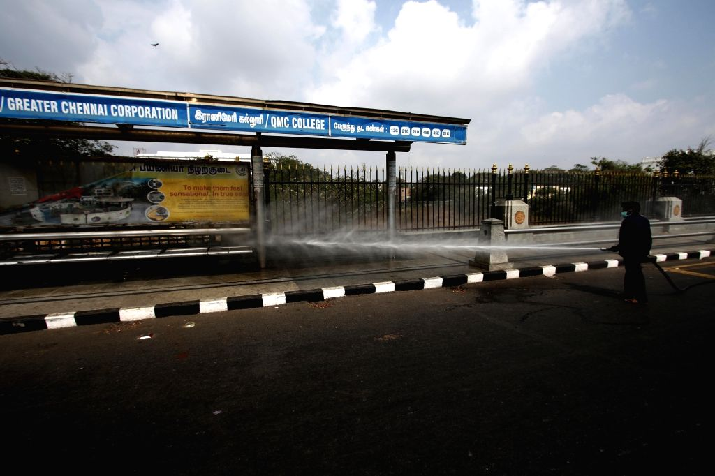 A bus stop being washed during nationwide shutdown - Janata Curfew - called by Prime Minister Narendra Modi as a measure to contain the spread of COVID-19, in Chennai on March 22, 2020. - Narendra Modi