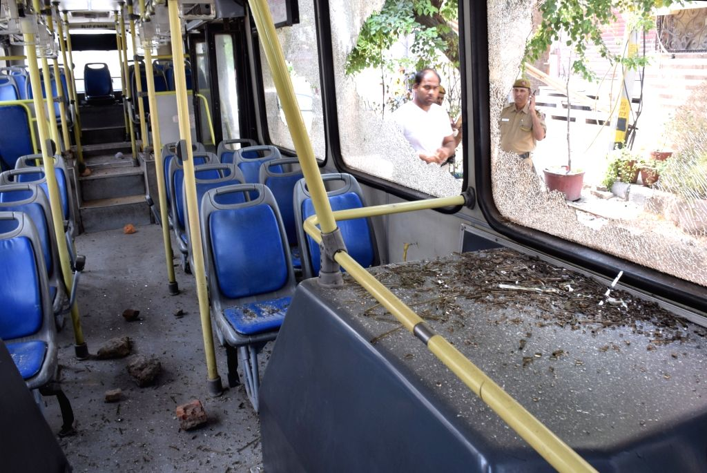A bus that was vandalised by public after a motorist rammed his car into devotees emerging from a mosque in Delhi's Khureji area on June 5, 2019. Police said no one was injured, denying ...