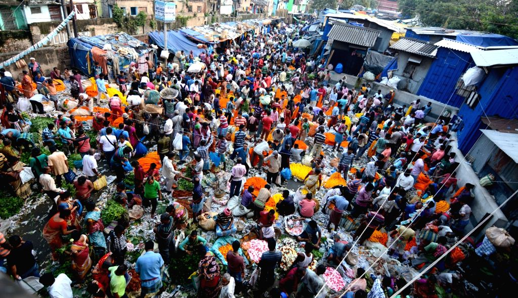 A busy flower market on the eve of Laxmi Puja, in Kolkata on Oct 12, 2019.