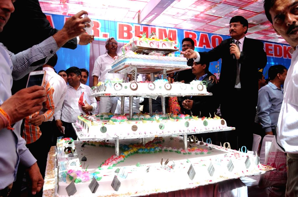 A cake weighing 125 kg during a programme organised by Dalit Indian Chamber of Commerce & Industry(DICCI) to celebrate 125th birth anniversary of Dr. BR Ambedkar in New Delhi, on April ...