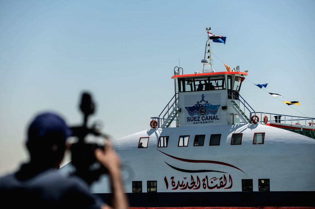 """A cameraman takes video clips on the new Suez Canal in Ismailia, a port city in Egypt, on July 29, 2015. The dredging work of Egypt's """"New Suez Canal"""" ..."""