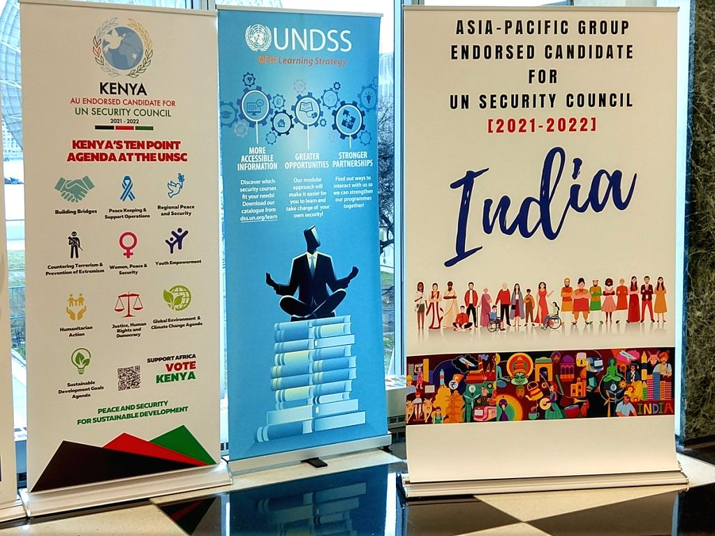 A campaign poster by India for the Security Council placed in the United Nations headquarters lobby is at right. Kenya's poster is at left. (Photo: Arul Louis/IANS)