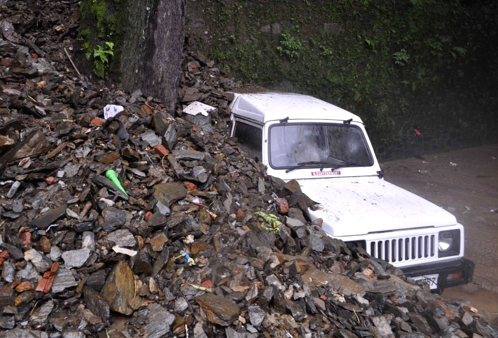 A car buried under the debris after a landslide triggered by heavy rainfall in Shimla on Aug 1, 2016.