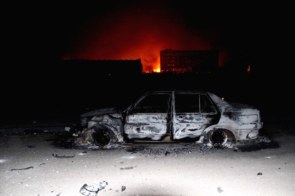 A car is damaged in the explosion in the Binhai New Area in north China's Tianjin Municipality, Aug. 13, 2015. The death toll from a Tianjin warehouse blast ...