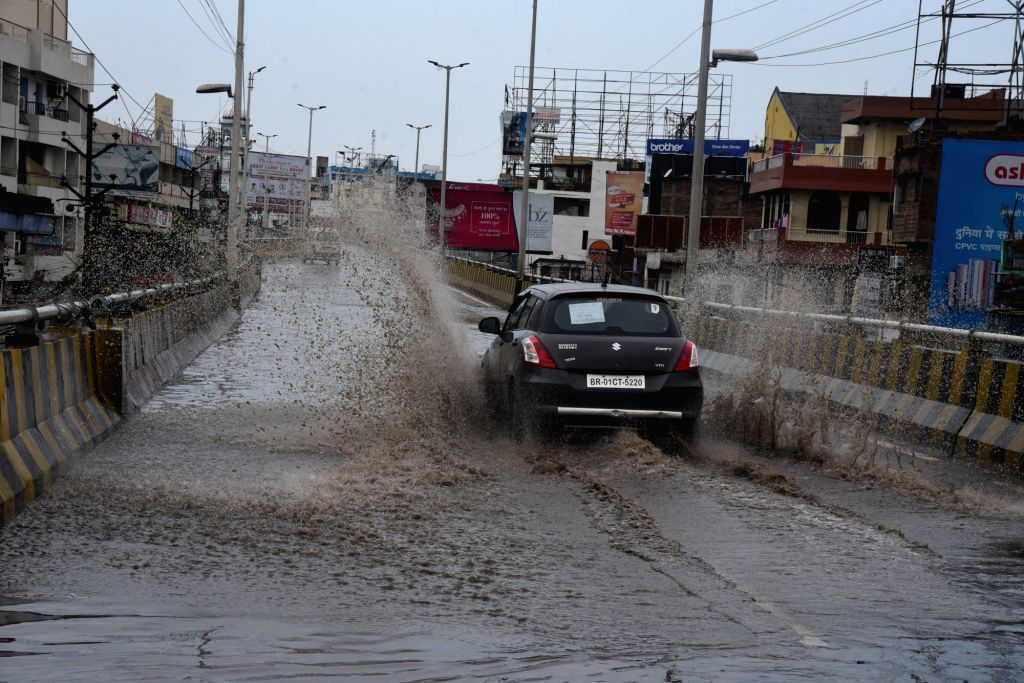 A car splashes through a water-logged street in Patna during the extended nationwide lockdown imposed to mitigate the spread of coronavirus; on Apr 26, 2020.