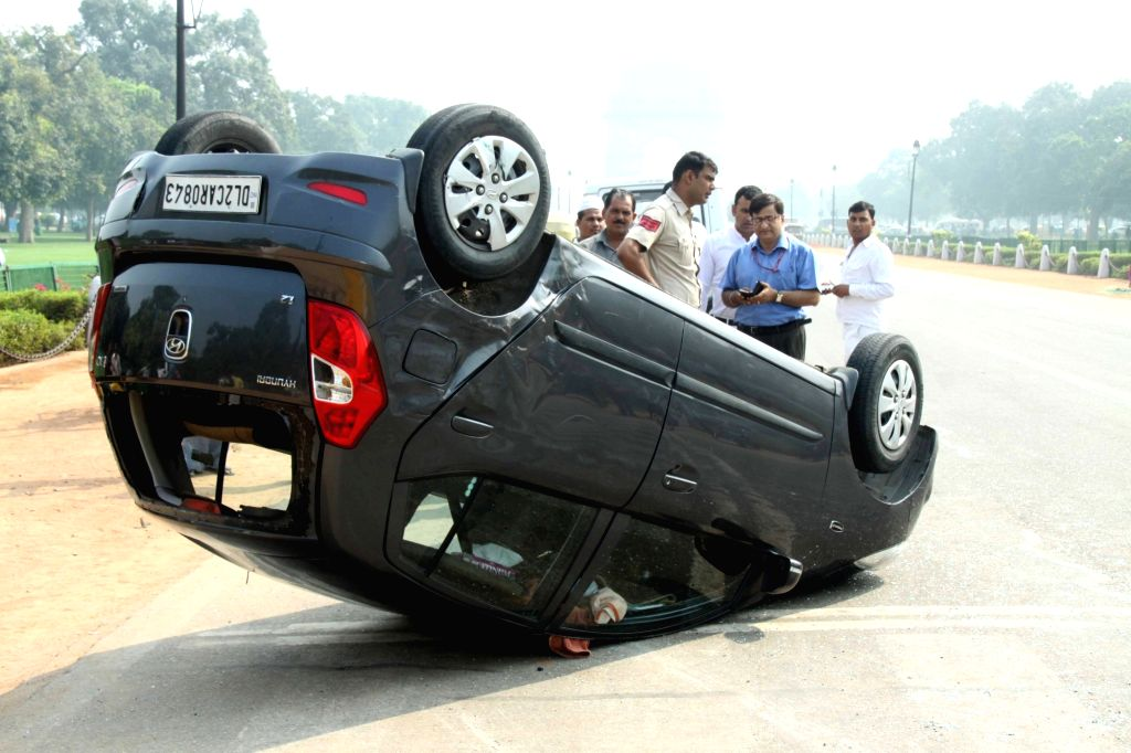 A car turns turtle near India Gate in New Delhi, on Oct 10, 2017.
