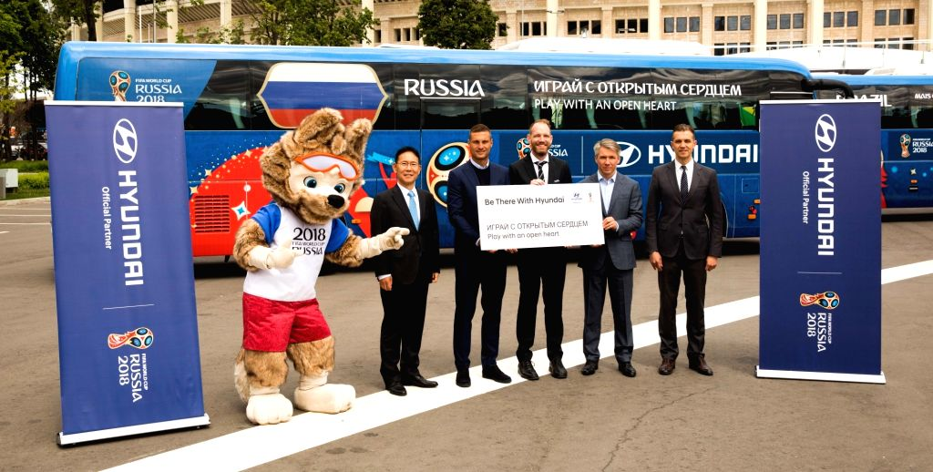 A ceremony is under way at a stadium in Moscow on May 31, 2018, for the delivery of vehicles of Hyundai Motor Group as official vehicles for the FIFA World Cup to be held in Russia on June ...