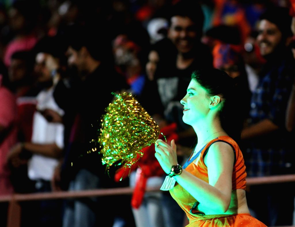 A cheerleader performs during an IPL match between Rising Pune Supergiants and Gujarat Lions at Saurashtra Cricket Association Stadium in Rajkot on April 14, 2016.