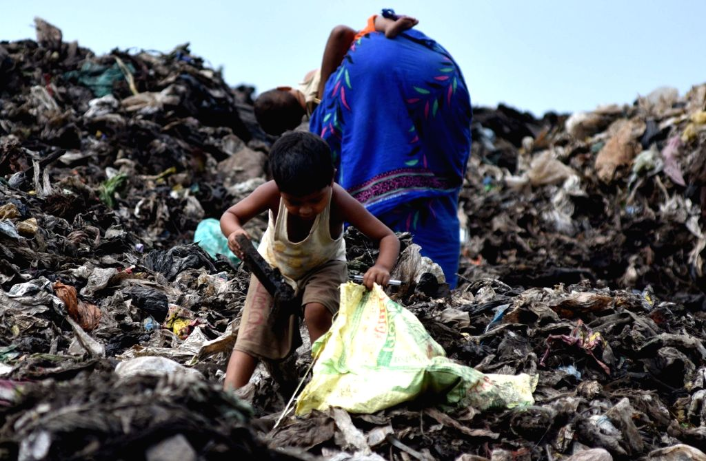 A child collects recyclable materials at a dumping ground in Guwahati on June 5, 2018. 5th June is observed as World Environment Day.