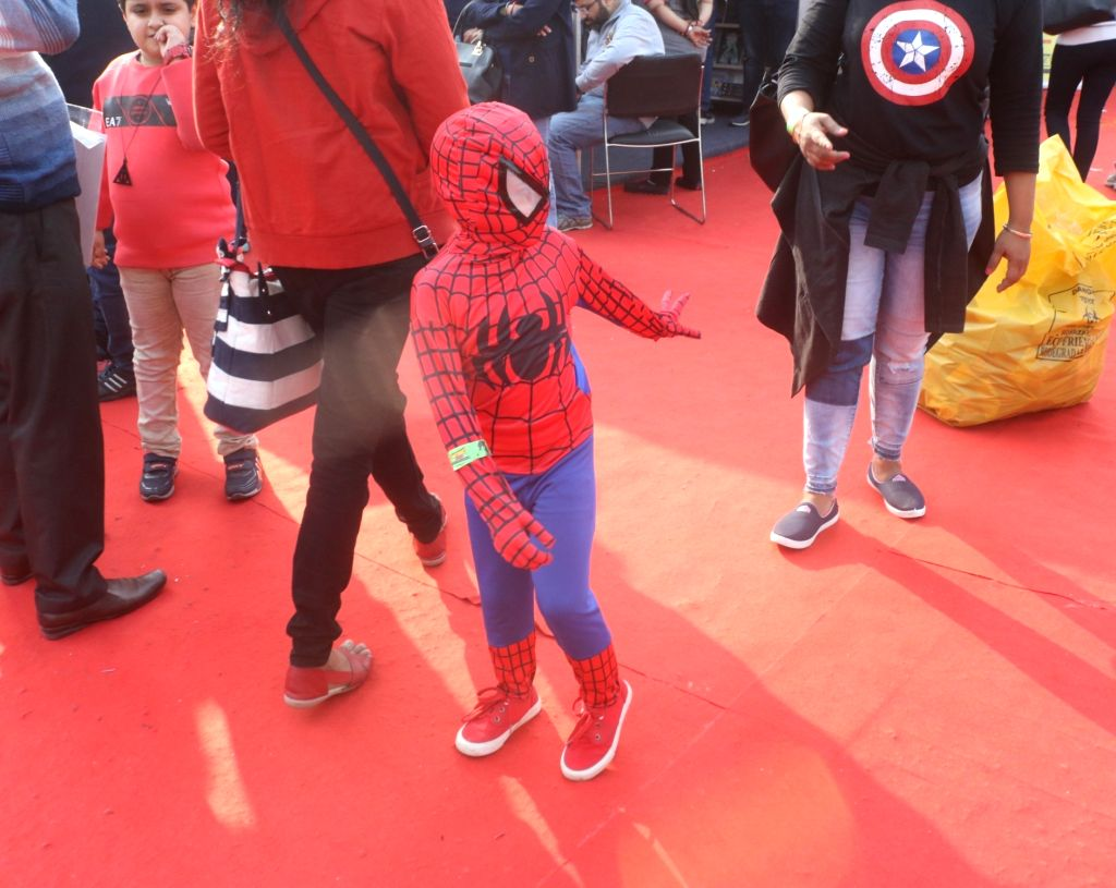 """A child dressed up as fictional superhero """"Spider-Man"""" at the three-day fest - """"Comic Con"""" in New Delhi on Dec 8, 2018."""