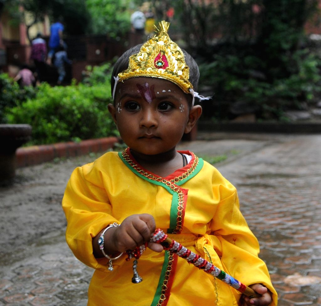 A child dressed up as Lord Krishna during Janmashtami celebrations, in New Delhi on Sept 3, 2018.