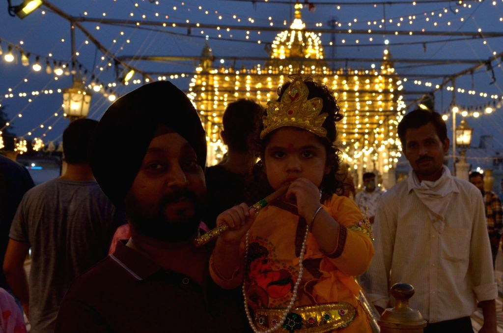 A child dressed up as young Lord Krishna at the Durgiana Temple on the eve of Janmashtami celebrations in Amritsar on Aug 11, 2020.