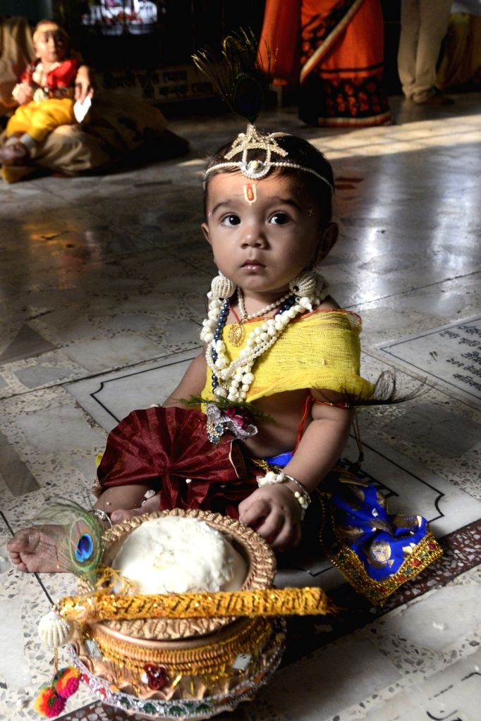 A child dresses up as Lord Krishna during Janmashtami festivities on the eve of the festival, in Kolkata on Sept 2, 2018.