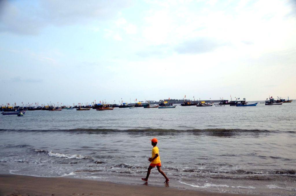 A child enjoys himself on Malvan sea beach in Sindhudurg district of Maharashtra on May 29, 2017.