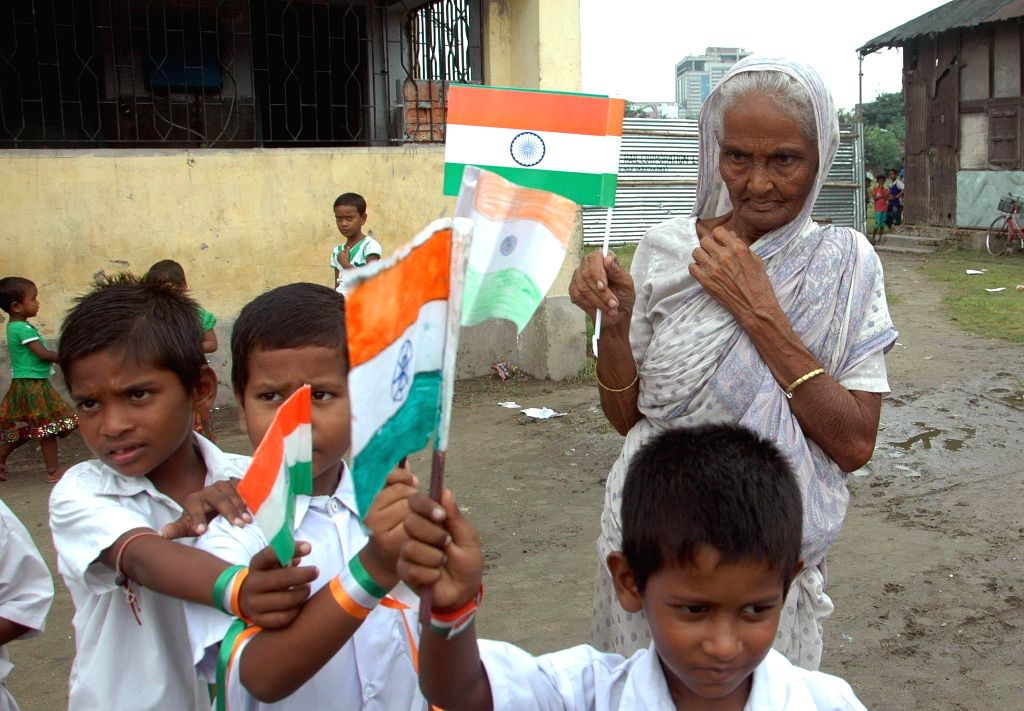 A child hold national flag as he celebrates Independence Day in Kolkata on Aug 15, 2014.